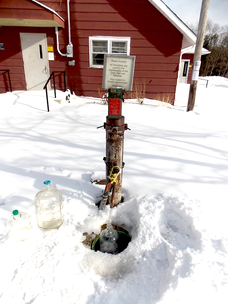community artesian well in winter